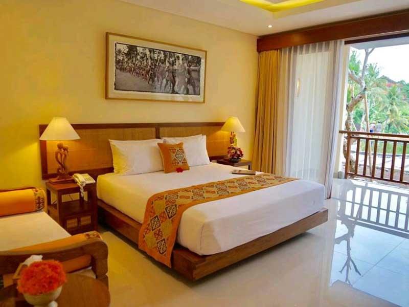 Eines der freundlich eingerichteten Zimmer einer Komfortunterkunft in Ubud