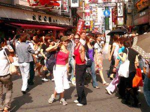 Riksja reizigers in Osaka, Japan
