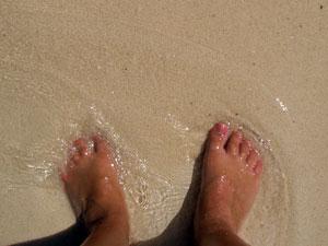 mexiko-strand-fuesse-im-sand