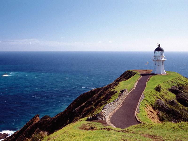 Blick auf den Leuchtturm von Cape Reinga und das offene Meer. - Nordinsel Neuseelands