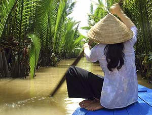 Rudern über die Nebenflüsse des Mekongs