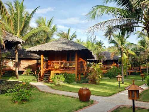 Bungalows im tropischen Garten