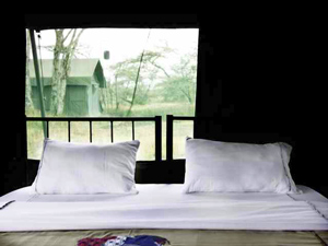 Serengeti private camp bed