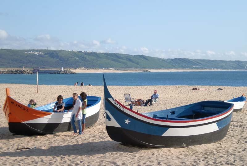 Portugal vakantie - boten strand